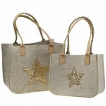 Filtpose med paljettstjerne naturlig sett med 2