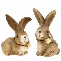 Dekorative figurer kaniner med fjær og treperler brun assortert 7cm x 4,9cm H 10cm 2stk