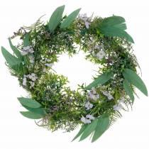 Dekorativ krans eukalyptus, bregne, blomster. Kunstig krans