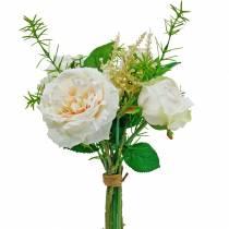Bukett med kunstige roser. Kremsilkeblomster i en bukett